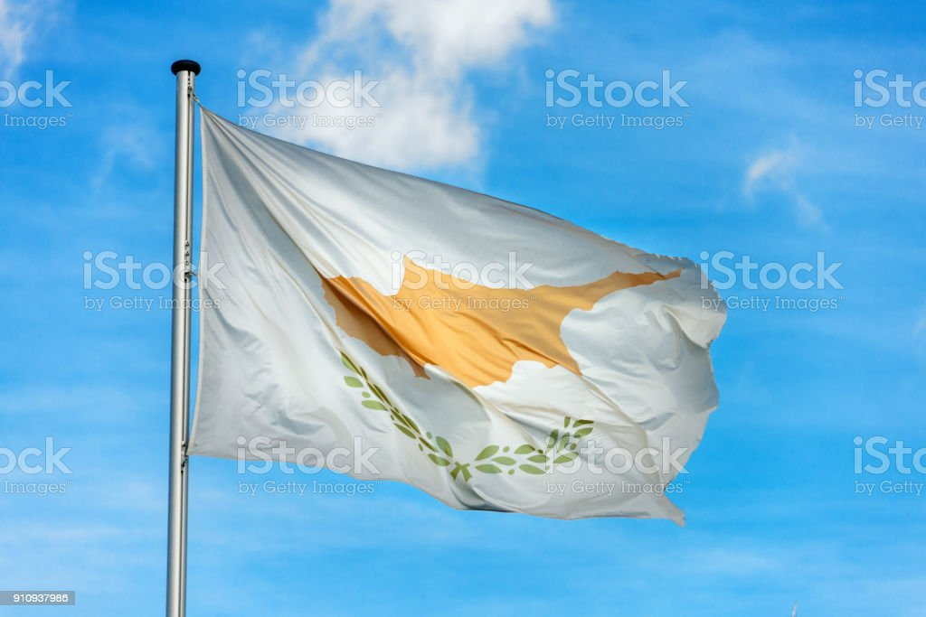 Cypriot flag waggling in the wind with sky stock photo