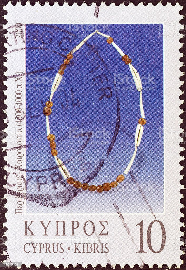 Cypriot stamp shows a necklace from Khirokitia (2000) royalty-free stock photo