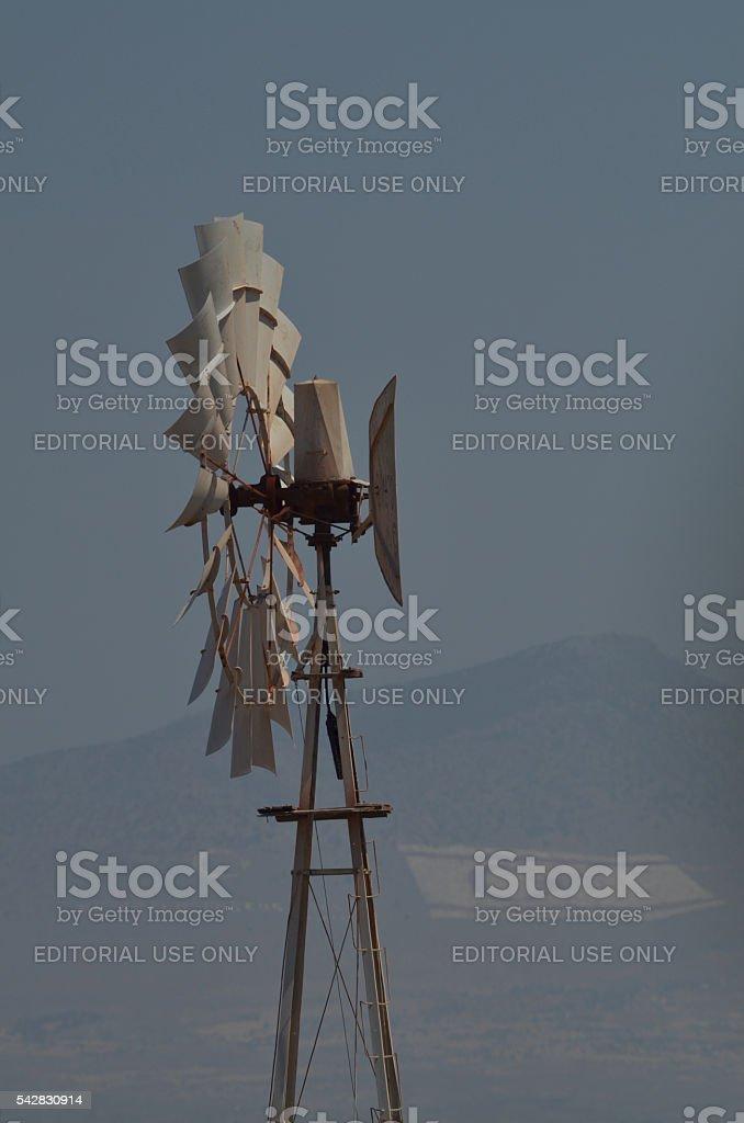 Cyprus windmill with Turkish flags on Kyrenia mountains stock photo