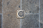 Aix-en-Provence, France - May 30, 2014: A pavement stud marks the walking path which takes visitors through places associated with  Paul Cézanne in Aix-en-Provence, France