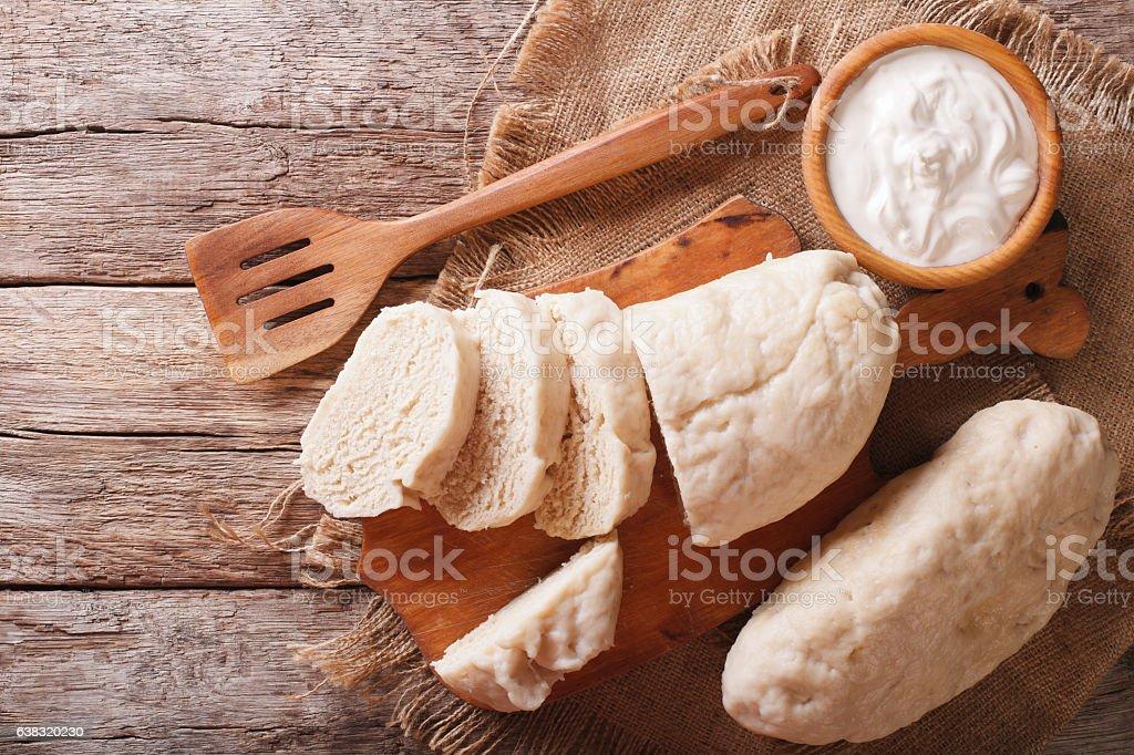 Czech cuisine: sliced boiled knedliks close-up on chopping board stock photo