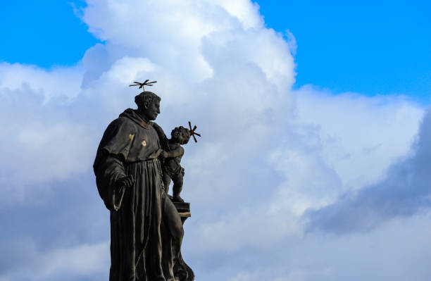 Czech, Prague, gothic sculpture of the Anthony of Padua on the Charles bridge. Prague, medieval art, statue of Saint on the bridge of King Charles. st. anthony of padua stock pictures, royalty-free photos & images