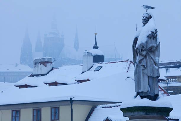 Czech Republic, Pague, Charles Bridge in snowfall stock photo