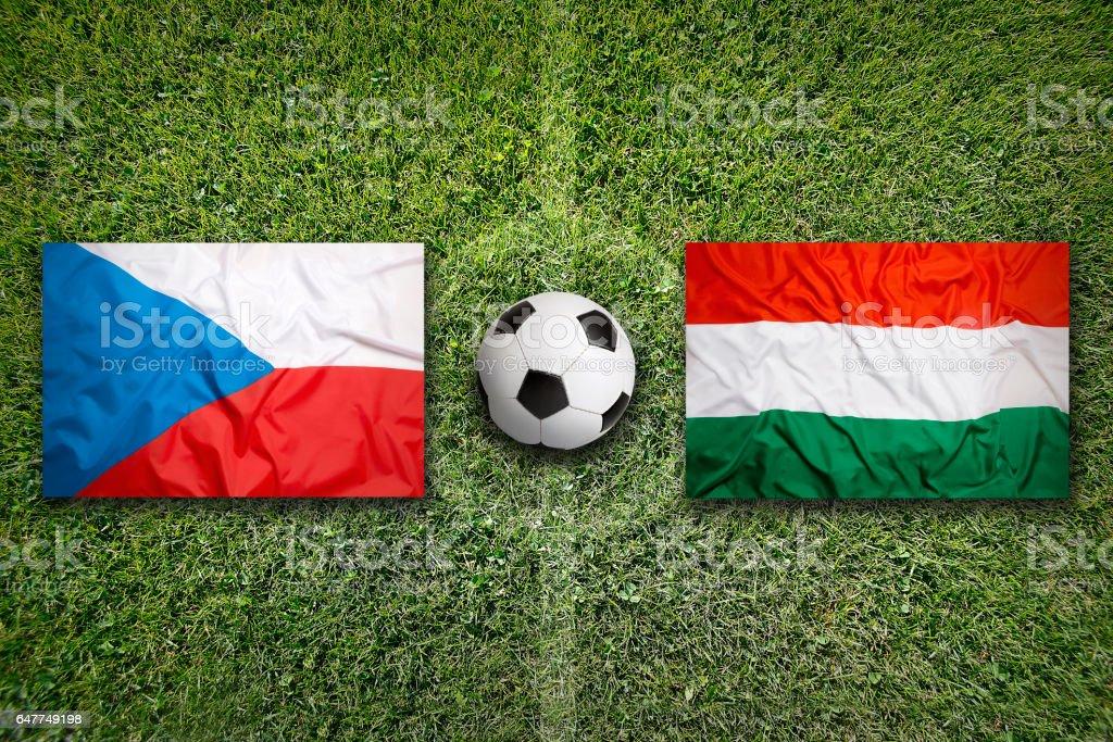 Czech Republic vs. Hungary flags on soccer field stock photo
