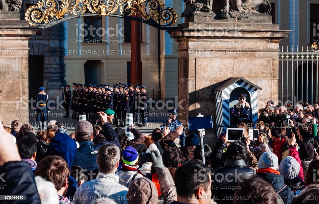 Czechia people and foreigner travelers waiting for the Changing The Guard at gate front of Prague castle in Prague, Czech Republic stock photo