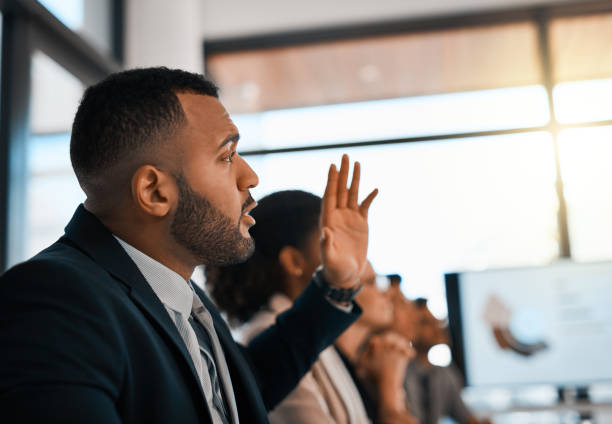 I'd like to add to that Shot of a young businessman raising his hand during a meeting in an office debate stock pictures, royalty-free photos & images