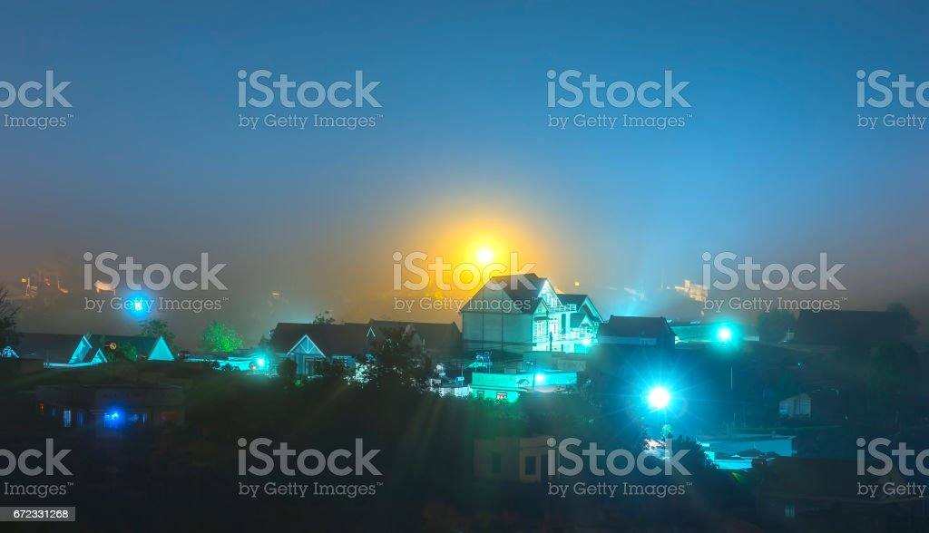 Da Lat city at night with many mist and light to make the scenery more beautiful night stock photo