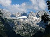 istock Dachstein mountain summit as seen from the crystal clear Gosausee in summer, Salzkammergut region, Upper Austria, Austria 1280702081