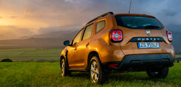 Dacia Duster SUV in the mountain wilderness during the evening downpour Poprad,Slovakia-July 2020:Dacia Duster SUV in the mountain wilderness during the evening downpour Dacia stock pictures, royalty-free photos & images