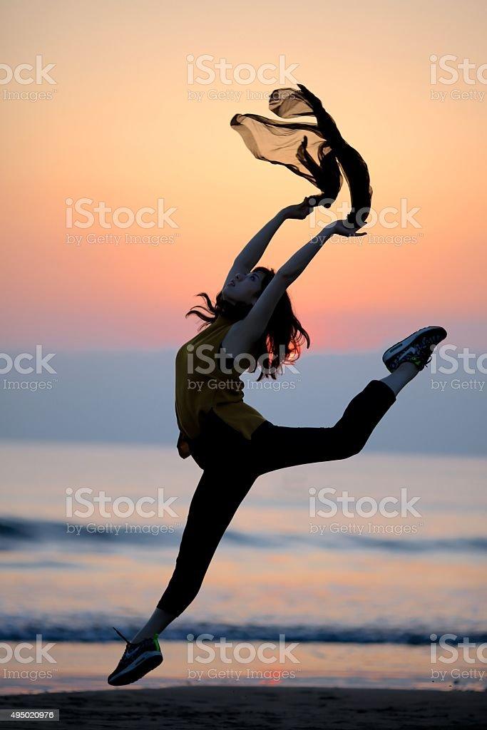 Dacing at sunset beach stock photo