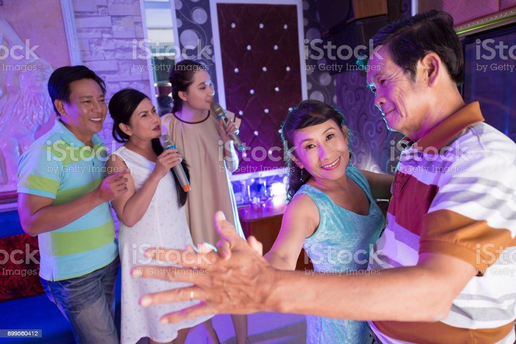 Dacing in karaoke stock photo