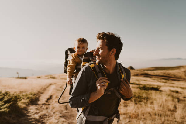 Dad and baby boy during the hike adventure stock photo