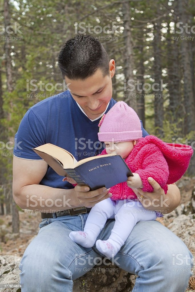 Dad and Baby Daughter Reading Bible stock photo