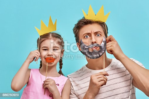 istock Dad and child are holding paper crown 686250920