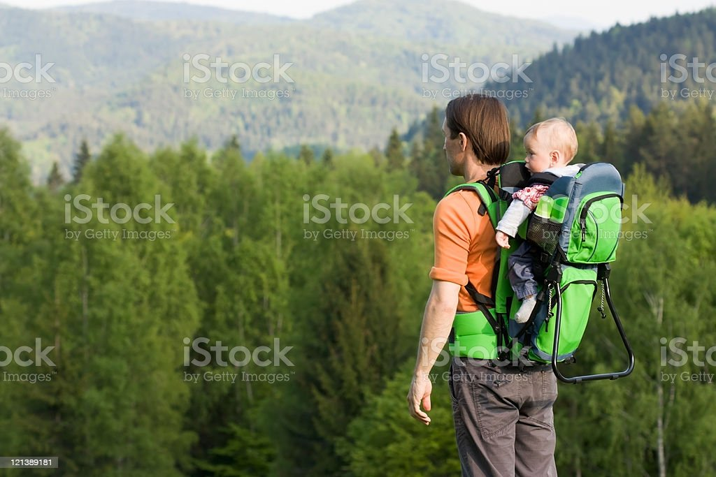 Dad and Child in Hiking Baby Carrier stock photo