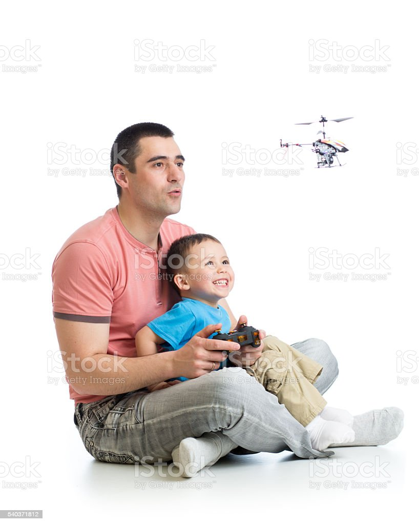 Dad and child son play with helicopter toy stock photo
