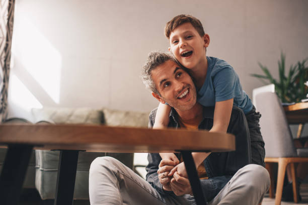Dad and cute little son sharing an emotional hug. stock photo
