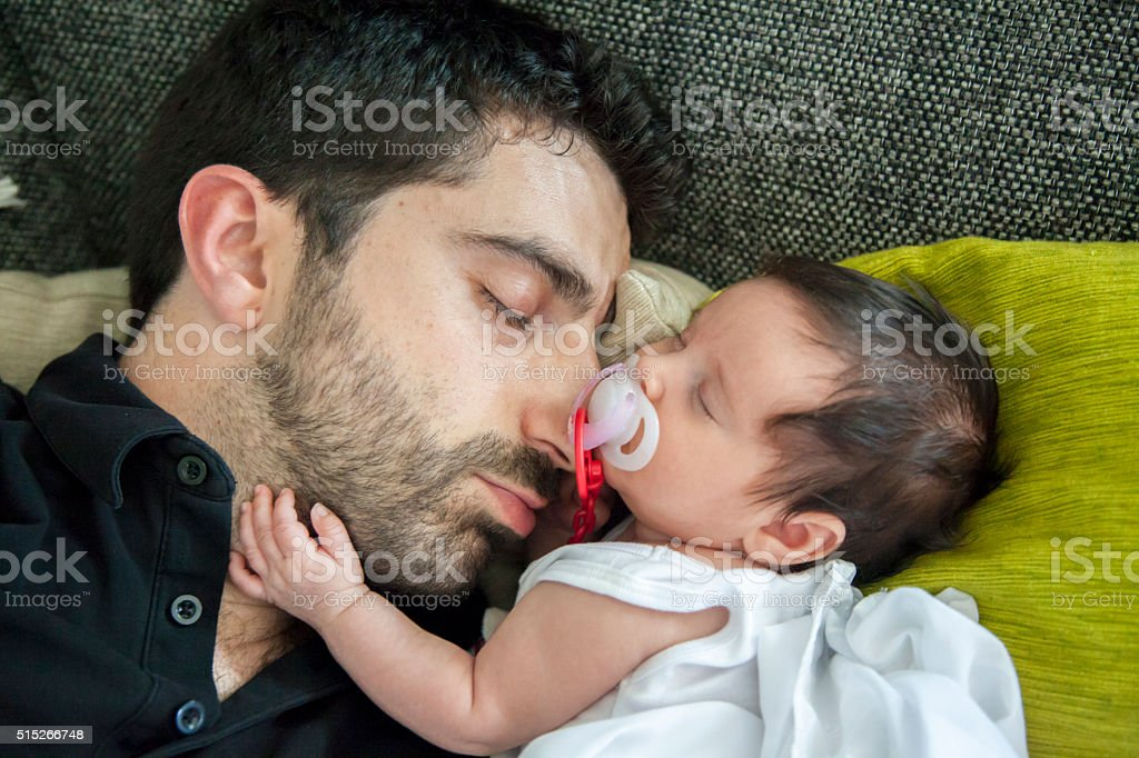 Dad and daughter having a nap together. - Royalty-free Babies Only Stock Photo