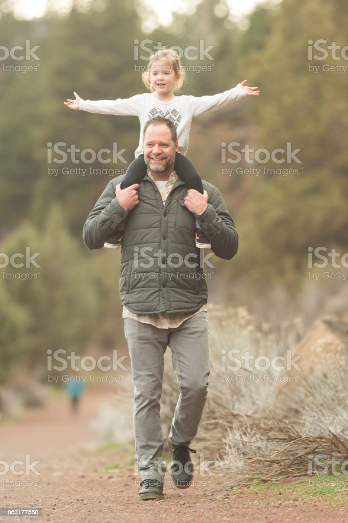 Dad and daughter hike in the wild stock photo