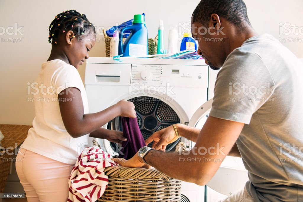 Dad and daughter houseworking together stock photo