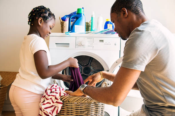 dad and daughter houseworking together - household chores stock photos and pictures