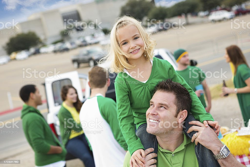 Dad and daughter tailgating with friends at football stadium royalty-free stock photo