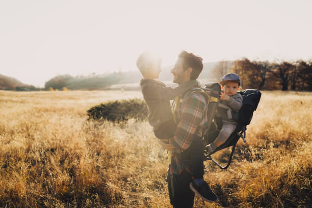 Dad and his boys hiking together stock photo