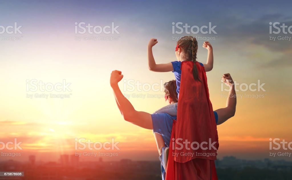 Dad and his daughter playing outdoors stock photo