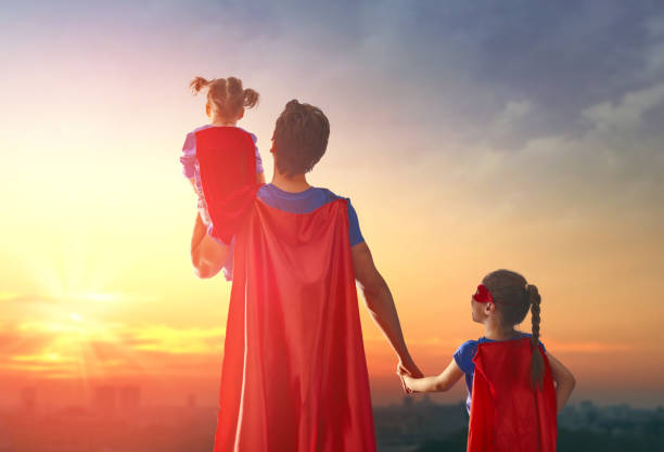 dad and his daughters are playing - baby super hero imagens e fotografias de stock
