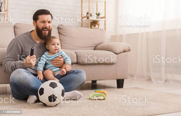 Dad and his son watching football at home picture id1135558885?b=1&k=6&m=1135558885&s=612x612&h=tdlbfm4npkof2rcooghmq67njepzssjsiubhitdzz90=
