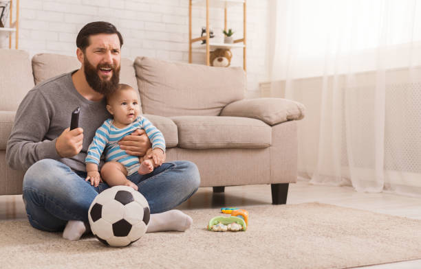 Dad and his son watching football at home picture id1135558885?b=1&k=6&m=1135558885&s=612x612&w=0&h=jqri5ibfdxzbnkxbgfivjxu5j52s 7jkrxwrjmfjzpy=