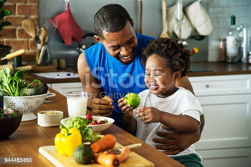 istock Dad and son cooking together 944483450