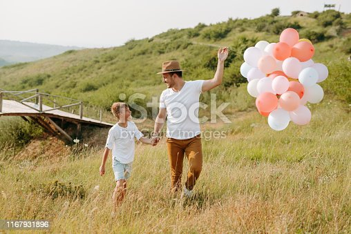 997711042istockphoto Dad and son in nature 1167931896