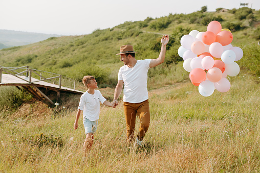 997711042 istock photo Dad and son in nature 1167931896