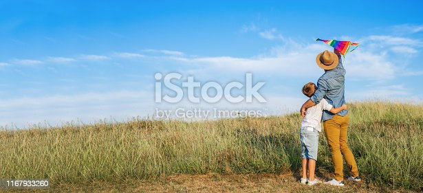 997711042istockphoto Dad and son in nature 1167933260
