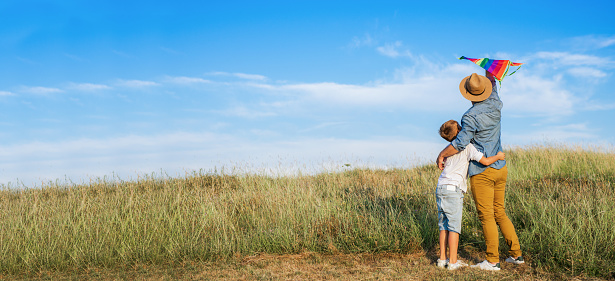 997711042 istock photo Dad and son in nature 1167933260