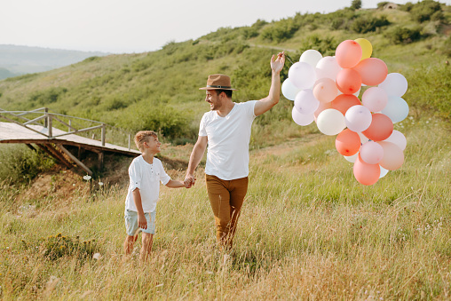 997711042 istock photo Dad and son in nature 1168941595