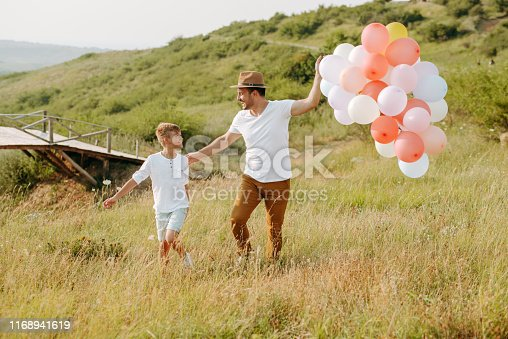 997711042istockphoto Dad and son in nature 1168941619