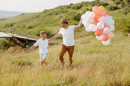 997711042 istock photo Dad and son in nature 1168941619