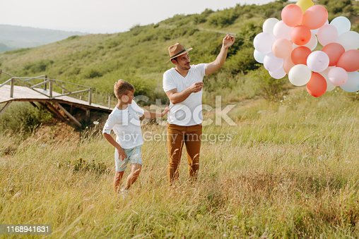 997711042istockphoto Dad and son in nature 1168941631