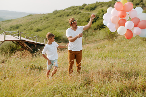 997711042 istock photo Dad and son in nature 1168941631