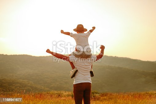 997711042istockphoto Dad and son in nature 1168941677