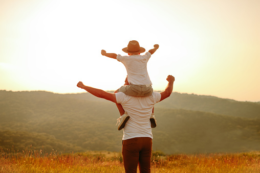 997711042 istock photo Dad and son in nature 1168941677