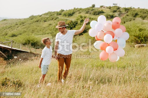 997711042istockphoto Dad and son in nature 1168941684