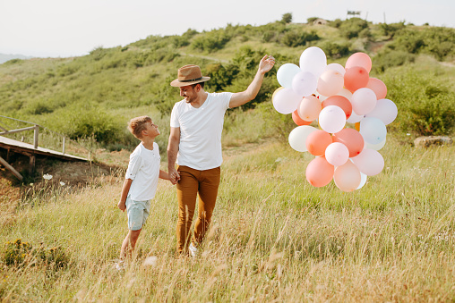 997711042 istock photo Dad and son in nature 1168941684