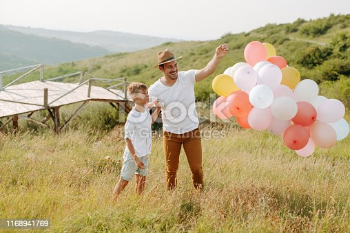997711042istockphoto Dad and son in nature 1168941769