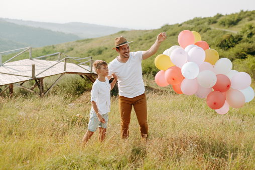 997711042 istock photo Dad and son in nature 1168941769