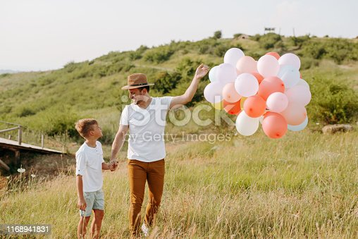 997711042istockphoto Dad and son in nature 1168941831