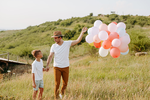 997711042 istock photo Dad and son in nature 1168941831