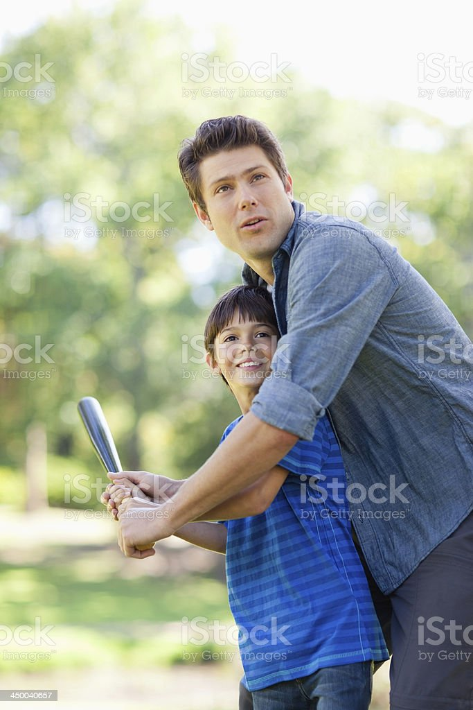 Dad and son look to sky seeing the ball flying stock photo